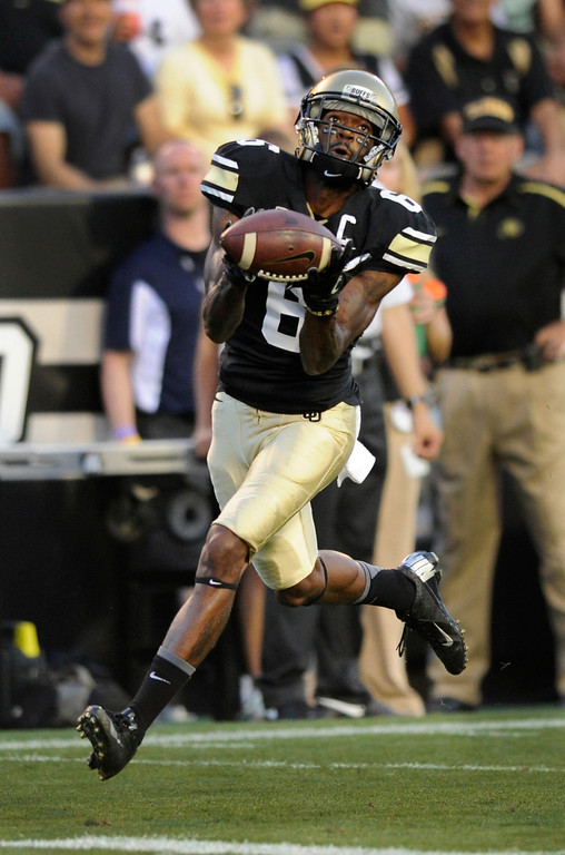. BOULDER, CO. - SEPTEMBER 76: Buffs receiver Paul Richardson grabbed a Connor Wood pass in the first quarter for a touchdown. The University of Colorado football team hosted Central Arkansas at Folsom Field Saturday night, September 7, 2013. Photo By Karl Gehring/The Denver Post