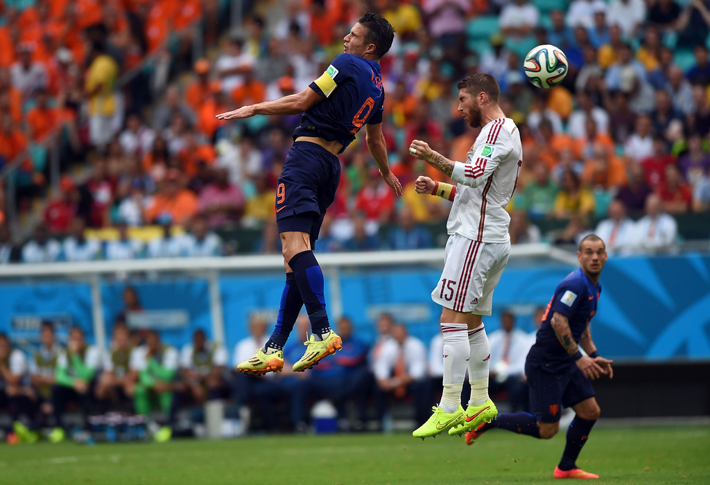 . Netherlands\' forward Robin van Persie (L) vies with Spain\'s defender Sergio Ramos (R) during a Group B football match between Spain and the Netherlands at the Fonte Nova Arena in Salvador during the 2014 FIFA World Cup on June 13, 2014.     AFP PHOTO / EMMANUEL DUNAND/AFP/Getty Images