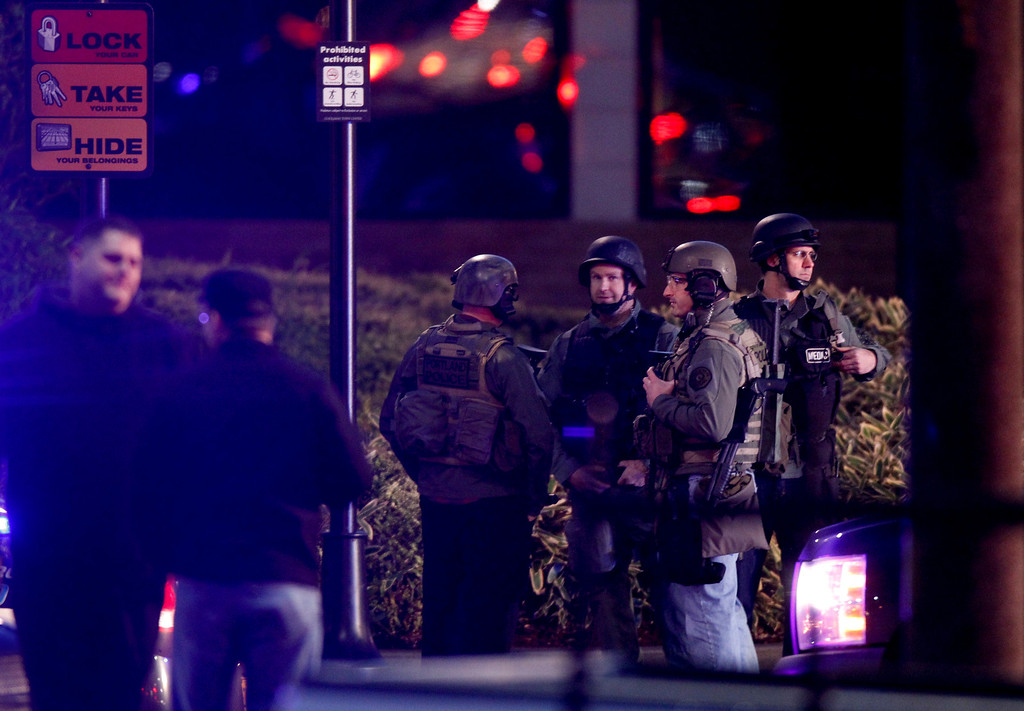. Law enforcement personnel work the scene of a shooting at the Clackamas Town Center in Clackamas, Ore. Tuesday, Dec. 11, 2012. A gunman opened fire in a Portland, Ore., area shopping mall Tuesday, killing at least one person and wounding an unknown number of others, sheriff\'s deputies said. (AP Photo/The Oregonian, Bruce Ely)