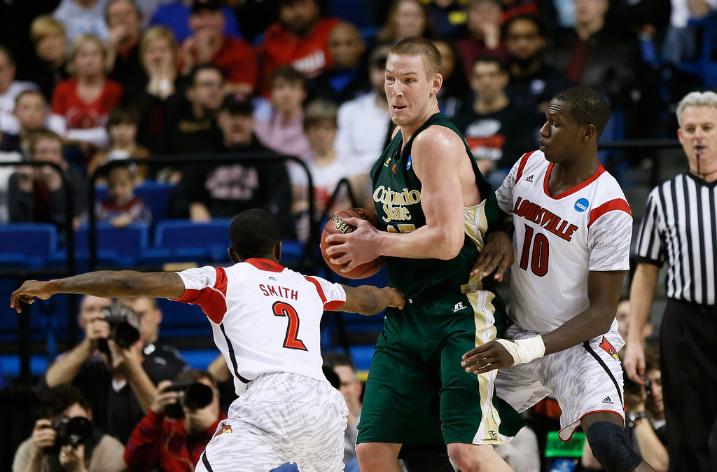 . LEXINGTON, KY - MARCH 23: Colton Iverson #45 of the Colorado State Rams handles the ball against Russ Smith #2 and Gorgui Dieng #10 of the Louisville Cardinals in the first half during the third round of the 2013 NCAA Men\'s Basketball Tournament at Rupp Arena on March 23, 2013 in Lexington, Kentucky.  (Photo by Kevin C. Cox/Getty Images)