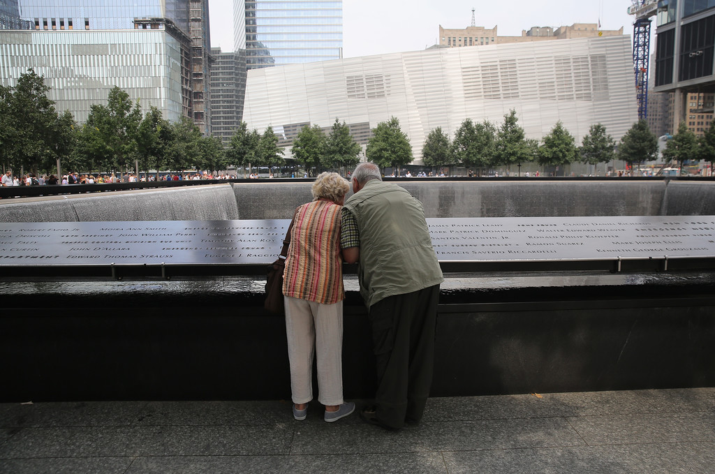 . NEW YORK, NY - SEPTEMBER 10:  Visitors to the 9/11 Memorial look at the names of victims on September 10, 2013 in New York City. Tomorrow marks the 12th anniversary of the attacks of September 11, 2001 that killed almost 3,000 people. The 9/11 Memorial has become a major tourist attraction for visitors to New York City. (Photo by John Moore/Getty Images)