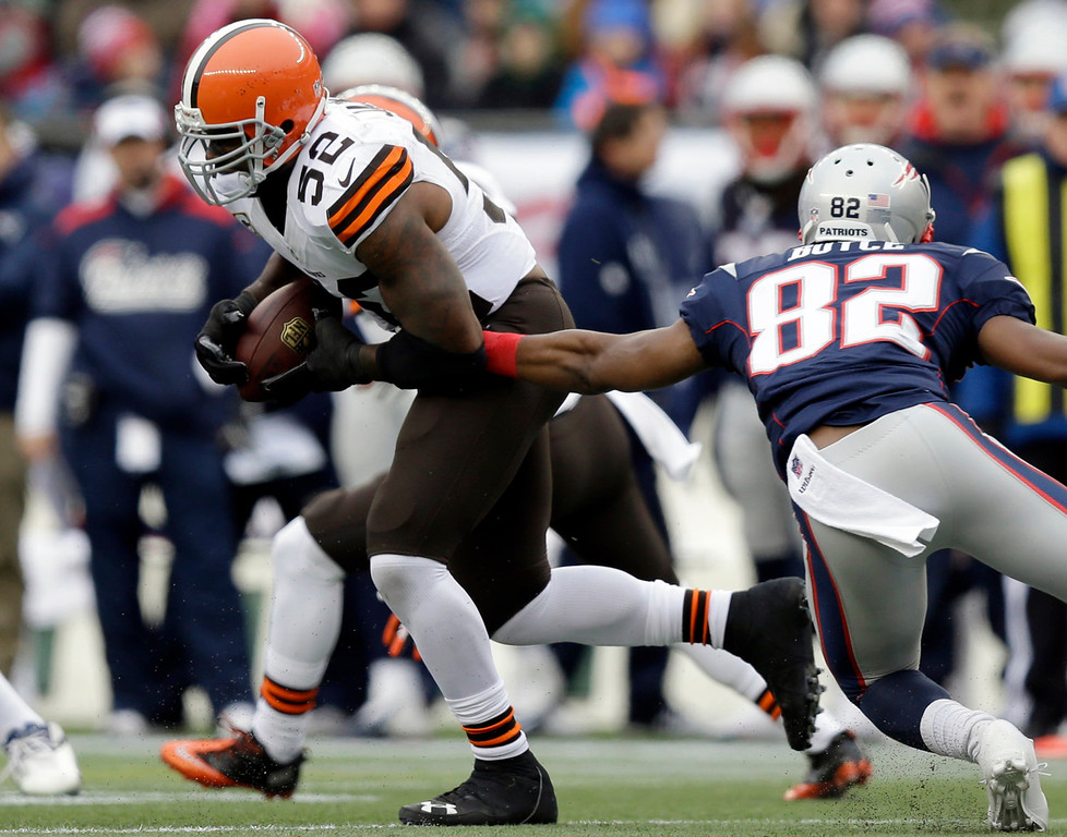 . Cleveland Browns linebacker D\'Qwell Jackson (52) runs from New England Patriots wide receiver Josh Boyce (82) after making an interception in the first quarter of an NFL football game on Sunday, Dec. 8, 2013, in Foxborough, Mass. (AP Photo/Steven Senne)