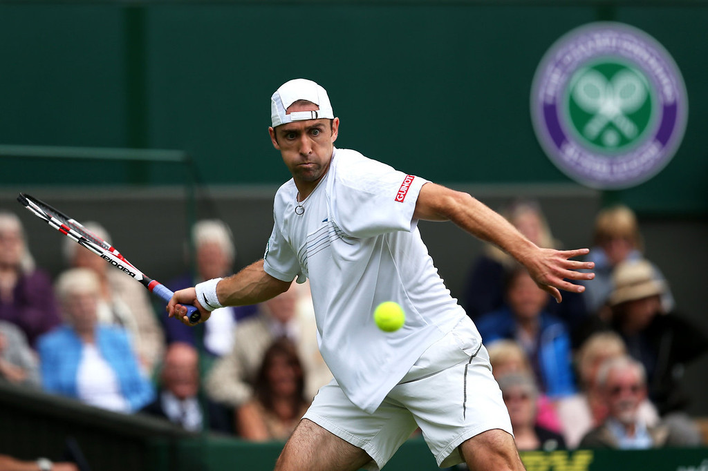 . Benjamin Becker of Germany plays a forehand during his Gentlemen\'s Singles first round match against Andy Murray of Great Britain on day one of the Wimbledon Lawn Tennis Championships at the All England Lawn Tennis and Croquet Club on June 24, 2013 in London, England.  (Photo by Clive Brunskill/Getty Images)