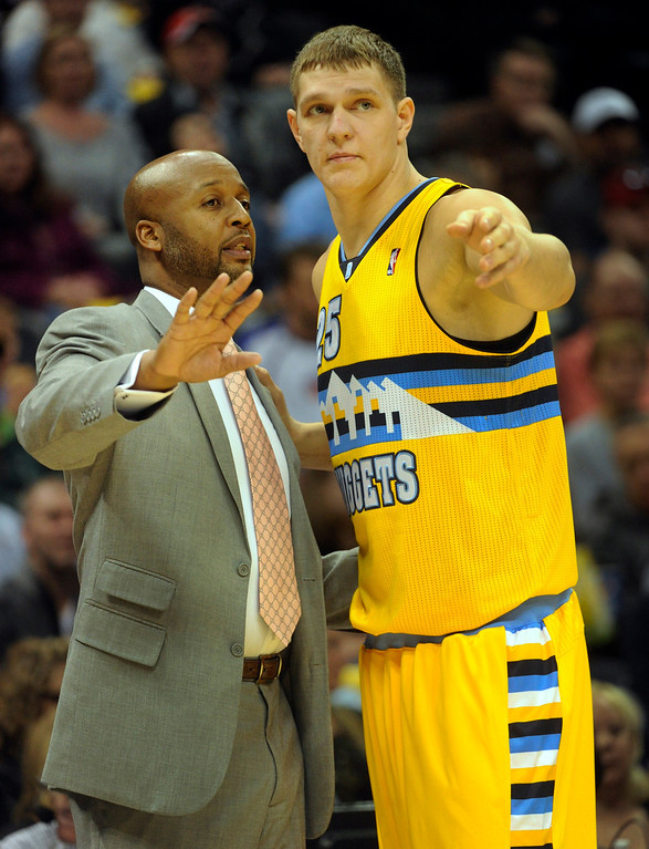 . DENVER, CO. - NOVEMBER 1:  Denver coach Brian Shaw shared his thoughts with center Timofey Mozgov in the first half. The Denver Nuggets hosted the Portland Trail Blazers Friday night, November 1, 2013 at the Pepsi Center.  Photo By Karl Gehring/The Denver Post