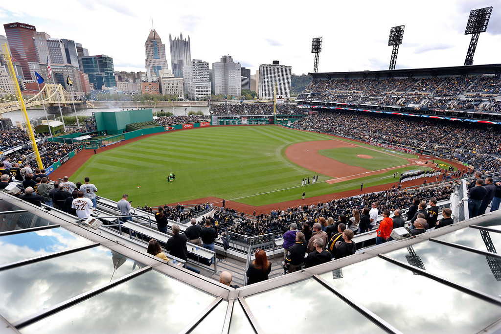 . The teams stand along the baselines during the singing of the national anthem at PNC Park before Game 4 of a National League baseball division series between the Pittsburgh Pirates and the St. Louis Cardinals on Monday, Oct. 7, 2013, in  Pittsburgh. (AP Photo/Keith Srakocic)