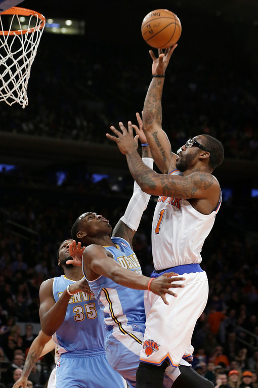 . New York Knicks\' Amare Stoudemire (1) shoots over Denver Nuggets\' Quincy Miller (30) during the first half of an NBA basketball game Friday, Feb. 7, 2014, in New York. (AP Photo/Frank Franklin II)