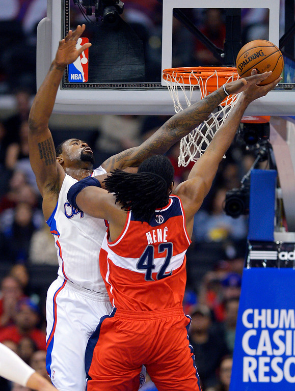 . Washington Wizards center Nene, right, of Brazil, puts up a shot as Los Angeles Clippers center DeAndre Jordan defends during the first half of their NBA basketball game, Saturday, Jan. 19, 2013, in Los Angeles.  (AP Photo/Mark J. Terrill)