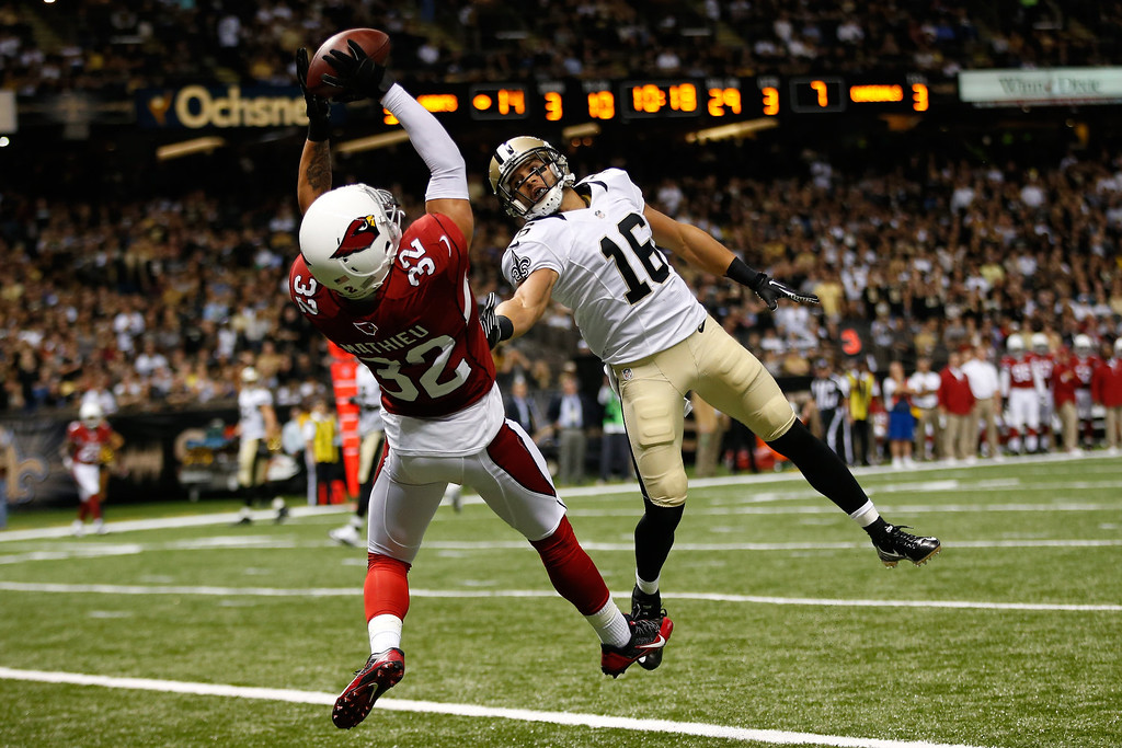 . Tyrann Mathieu #32 of the Arizona Cardinals intercepts a ball in the endzone over  Lance Moore #16 of the New Orleans Saints at the Mercedes-Benz Superdome on September 22, 2013 in New Orleans, Louisiana.  (Photo by Chris Graythen/Getty Images)