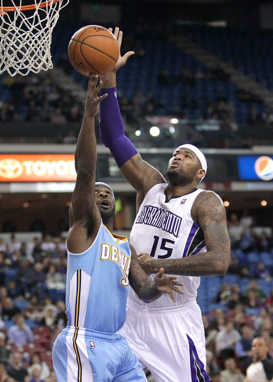 . Sacramento Kings center DeMarcus Cousins, right, blocks the shot of Denver Nuggets guard Ty Lawson during the first quarter of an NBA basketball game in Sacramento, Calif., Tuesday, March 5, 2013. (AP Photo/Rich Pedroncelli)