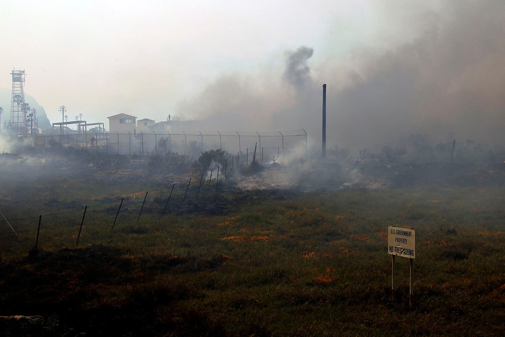. A brush fire burns at a shooting range on the beach at Navel Base Ventura County  Friday, May 3, 2013.   (AP Photo/Nick Ut)