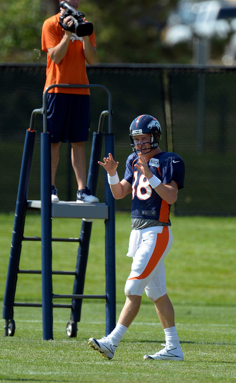 . Denver Broncos quarterback Peyton Manning (18) gives out instructions during drills at practice August 20, 2013 at Dove Valley (Photo by John Leyba/The Denver Post)
