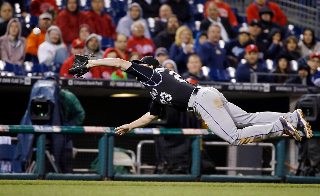 . Colorado Rockies third baseman Charlie Culberson dives for a pop foul by Philadelphia Phillies\' Tony Gwynn during the sixth inning of a baseball game, Wednesday, May 28, 2014, in Philadelphia. Culberson made the catch. Philadelphia won 6-3. (AP Photo/Matt Slocum)