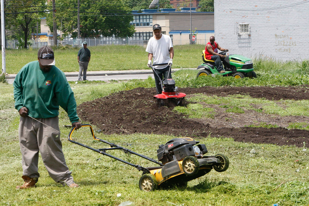 ". In this Thursday, May 20, 2010 photo, work crews clear out an empty lot in Detroit, . A nonprofit that puts vacant urban land to use for growing food will kick off work next week on one of several new community gardens it\'s planning for the Detroit area under a nationwide partnership with Kraft Foods Inc.\'s Triscuit brand. Next Thursday\'s planned groundbreaking is part of an effort that Detroit-based Urban Farming and Triscuit began in March to create about 50 ""home farms\"" in 20 areas around the U.S. from Los Angeles to Washington, D.C. (AP Photo/Carlos Osorio)"