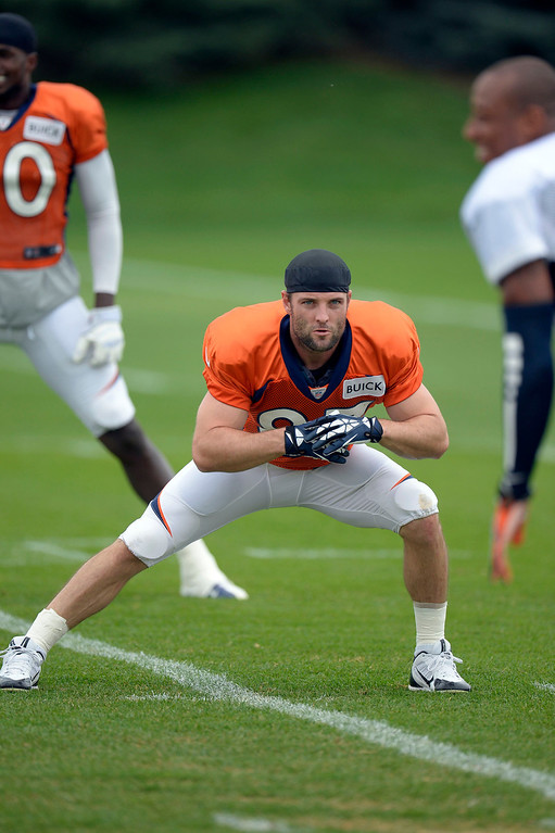 . Denver Broncos wide receiver Wes Welker (83) stretches before practice September 1, 2013 at Dove Valley. (Photo by John Leyba/The Denver Post)