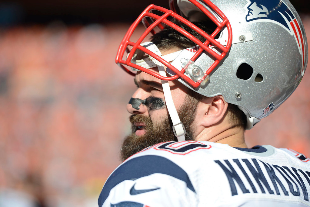 . New England Patriots defensive end Rob Ninkovich (50) on the Patriots\' bench before the game. The Denver Broncos take on the New England Patriots in the AFC Championship game at Sports Authority Field at Mile High in Denver on January 19, 2014. (Photo by AAron Ontiveroz/The Denver Post)
