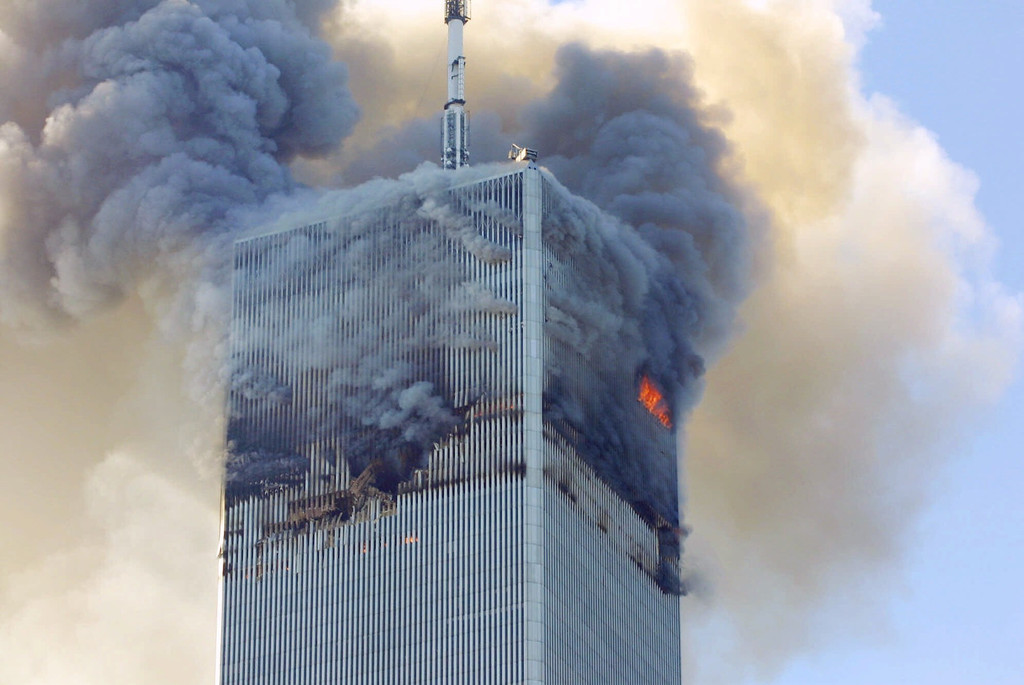 . Fire and smoke billows from the north tower of New York\'s World Trade Center Tuesday Sept. 11, 2001 after terrorists crashed two hijacked airliners into the World Trade Center and brought down the twin 110-story towers.  (AP Photo/David Karp)