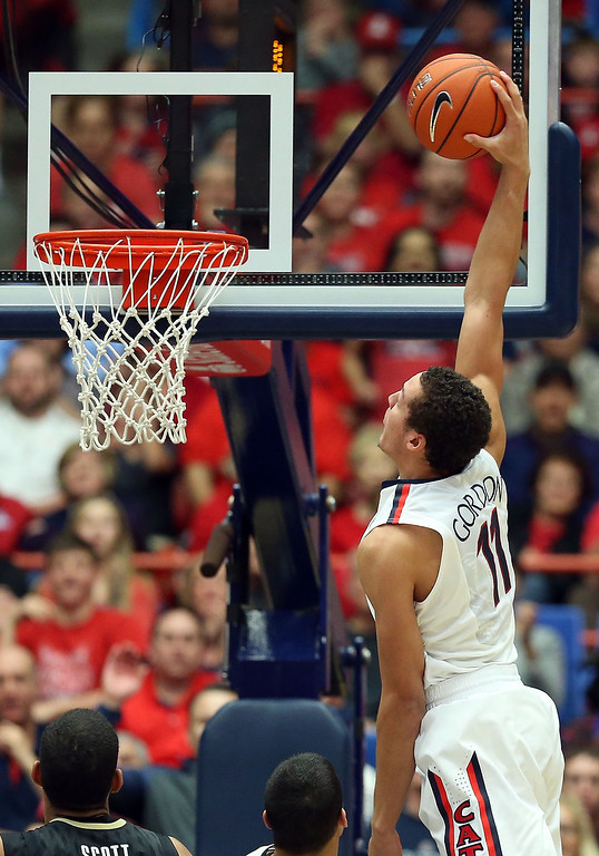 . Aaron Gordon #11 of the Arizona Wildcats slam dunks the ball against the Colorado Buffaloes during the second half of the college basketball game at McKale Center on January 23, 2014 in Tucson, Arizona. The Wildcats defeated the Buffaloes 69-57.  (Photo by Christian Petersen/Getty Images)