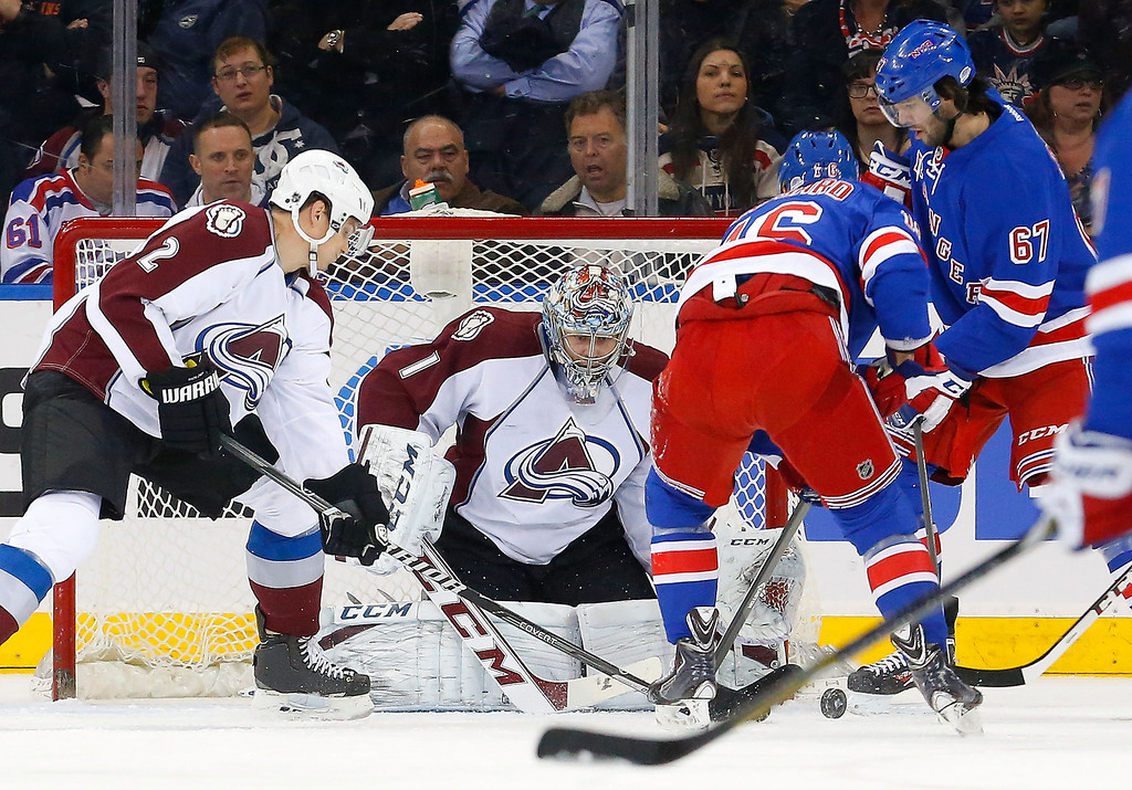 . Semyon Varlamov #1 and Nick Holden #2 of the Colorado Avalanche defend the net in the first period against Derick Brassard #16 and Benoit Pouliot #67 of the New York Rangers at Madison Square Garden on February 4, 2014 in New York City.  (Photo by Jim McIsaac/Getty Images)