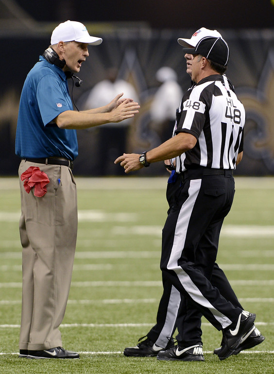 . Miami Dolphins head coach Joe Philbin talks to officials in the first half of an NFL football game against the New Orleans Saints in New Orleans, Monday, Sept. 30, 2013. (AP Photo/Bill Feig)