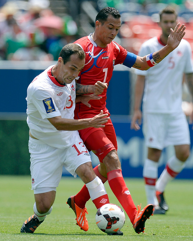 . Pedro Pacheco Melo #13 of Canada battles with Blas Perez for the ball during the first half of the CONCACAF Gold Cup soccer game July 14, 2013 at Sports Authority Field at Mile High. (Photo By John Leyba/The Denver Post)