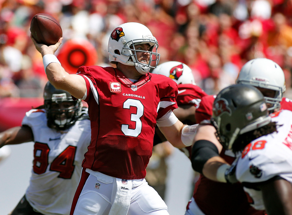 . Arizona Cardinals quarterback Carson Palmer (3) throws a pass as he is pressured by Tampa Bay Buccaneers defensive end Steven Means (96), right,  during the first quarter of an NFL football game Sunday, Sept. 29, 2013, in Tampa, Fla. (AP Photo/Reinhold Matay)