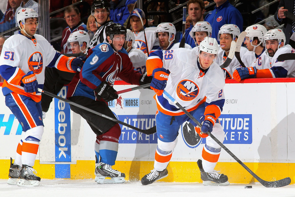 . DENVER, CO - JANUARY 10:  Brock Nelson #29 of the New York Islanders controls the puck as Matt Duchene #9 of the Colorado Avalanche and Frans Nielsen #51 of the New York Islanders follow the play at Pepsi Center on January 10, 2014 in Denver, Colorado.  (Photo by Doug Pensinger/Getty Images)
