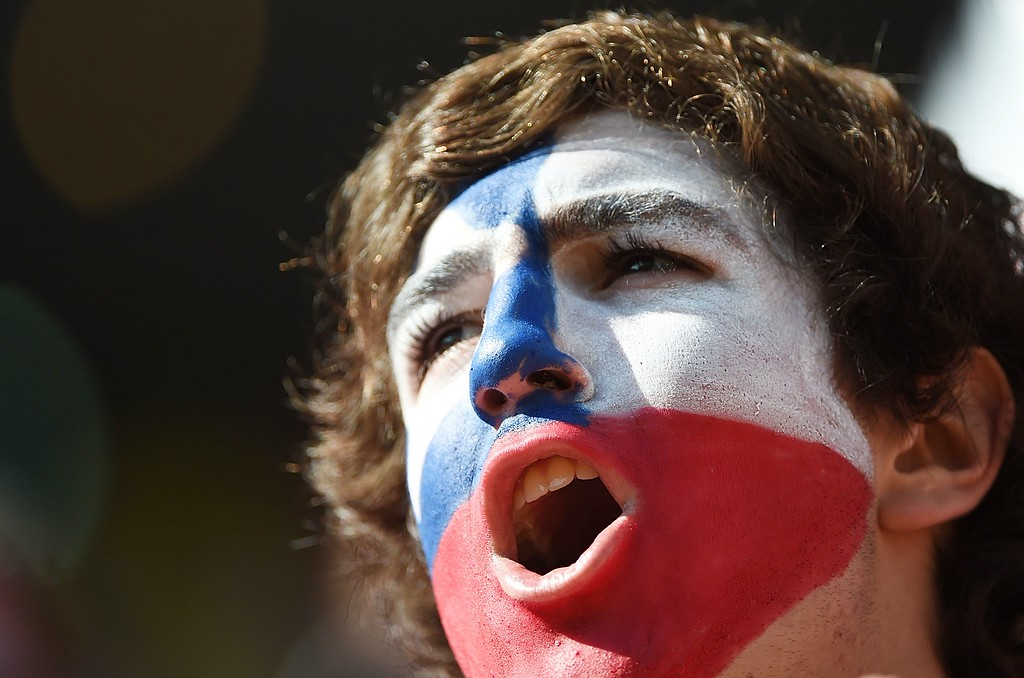 . A Chile fan cheers prior to the Group B football match between Netherlands and Chile at the Corinthians Arena in Sao Paulo during the 2014 FIFA World Cup on June 23, 2014.  AFP PHOTO / CHRISTOPHE SIMON/AFP/Getty Images