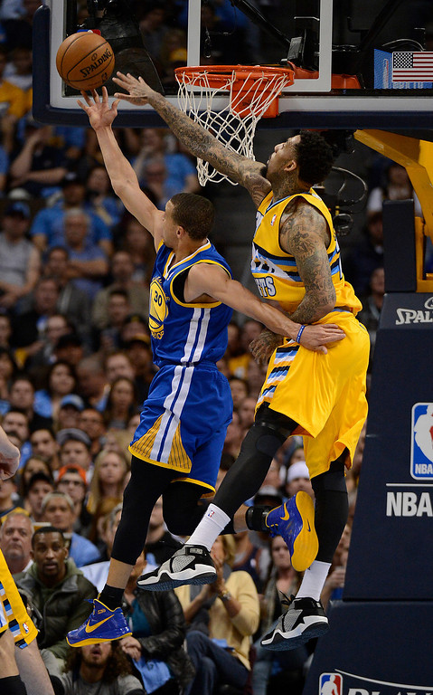 . DENVER, CO. - APRIL 23: Golden State Warriors point guard Stephen Curry (30) puts up a shot against Denver Nuggets shooting guard Wilson Chandler (21) in the second quarter. The Denver Nuggets took on the Golden State Warriors in Game 2 of the Western Conference First Round Series at the Pepsi Center in Denver, Colo. on April 23, 2013. (Photo by John Leyba/The Denver Post)