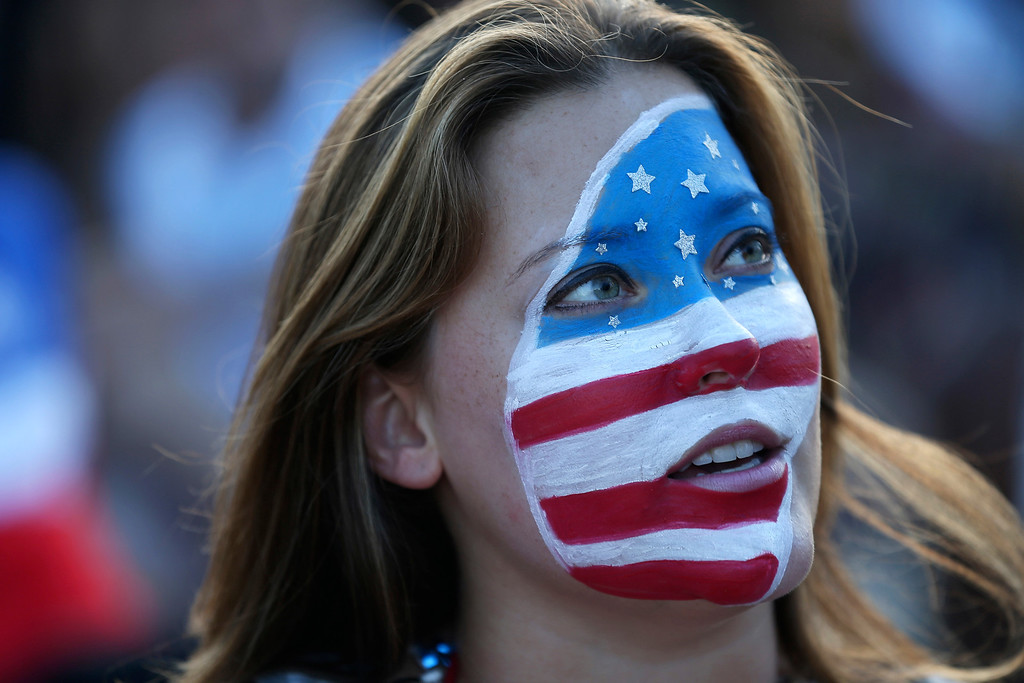 . A USA soccer fan waits for their team\'s game against Portugal at the FIFA Fan Fest on Copacabana beach June 22, 2014 in Rio de Janeiro, Brazil.  (Photo by Joe Raedle/Getty Images)