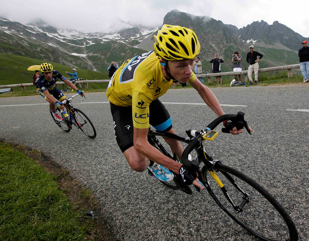 . Race leader jersey holder Team Sky rider Christopher Froome of Britain cycles during the 204.5 km stage of the centenary Tour de France cycling race from Bourg d\'Oisans to Le Grand Bornand, in the French Alps, July 19, 2013.    REUTERS/Jacky Naegelen