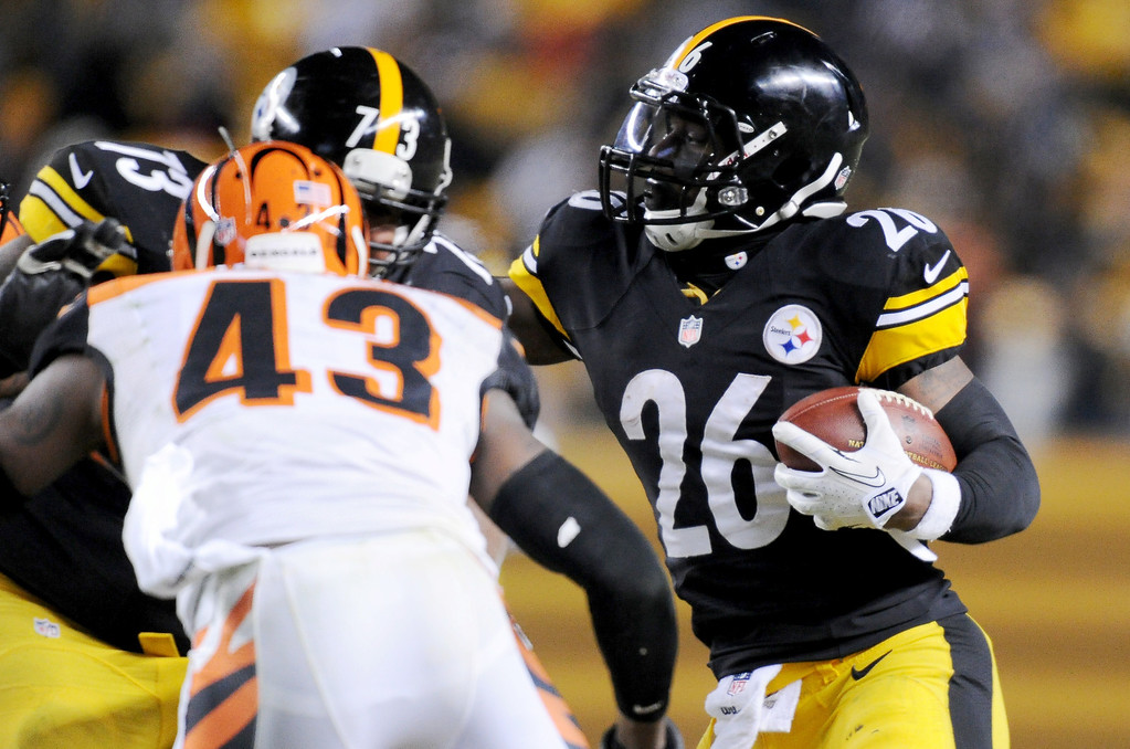 . Pittsburgh Steelers running back Le\'Veon Bell (26) runs towards Cincinnati Bengals strong safety George Iloka (43) in the third quarter of an NFL football game on Sunday, Dec. 15, 2013, in Pittsburgh. (AP Photo/Don Wright)