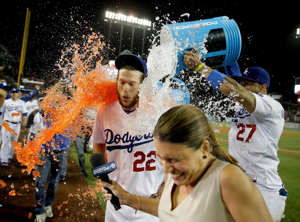 . Los Angeles Dodgers starting pitcher Clayton Kershaw celebrates his no-hitter against the Colorado Rockies after a baseball game in Los Angeles, Wednesday, June 18, 2014. (AP Photo/Chris Carlson)