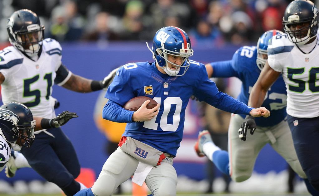 . Quarterback Eli Manning #10 of the New York Giants is sacked in the 1st half  against the Seattle Seahawks at MetLife Stadium on December 15, 2013 in East Rutherford, New Jersey. (Photo by Ron Antonelli/Getty Images)