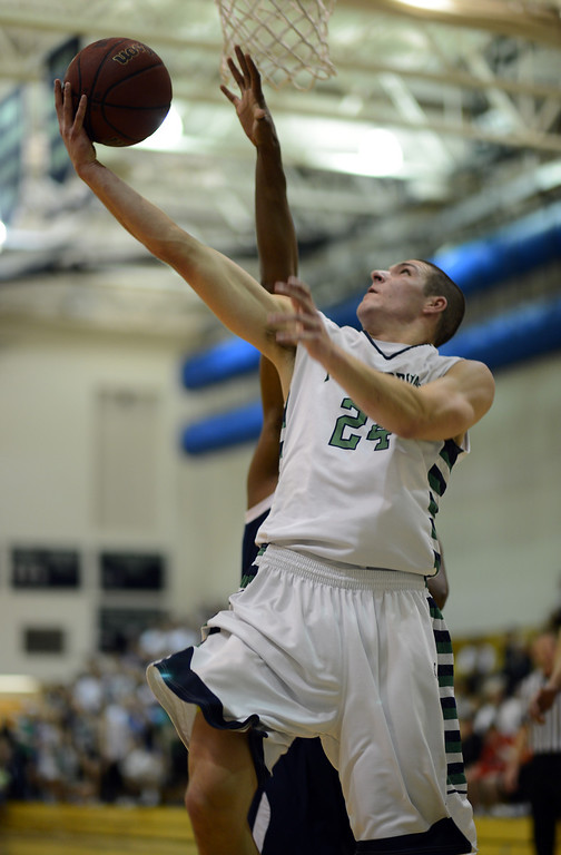 . HIGHLANDS RANCH, CO. - MARCH 02: Zach Rusk of ThunderRidge High School #24 makes the basket during the 2nd round of 5A playoff game against Overland High School at ThunderRidge High School. March 2, 2013. Highlands Ranch , Colorado. ThunderRidge won 67-57. (Photo By Hyoung Chang/The Denver Post)