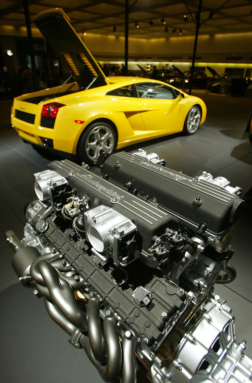 . The Lamborghini Murcielago engine stands on display in the foreground with the Lamborghini Gallardo in background at the 2005 Los Angeles Auto Show January 5, 2005 in Los Angeles, California.  (Photo by J. Emilio Flores/Getty Images)