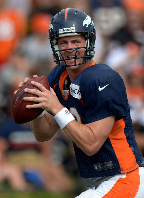 . Denver Broncos QB Peyton Manning (18) drops back to pass in drills during training camp August 1, 2013 at Dove Valley. (Photo By John Leyba/The Denver Post)