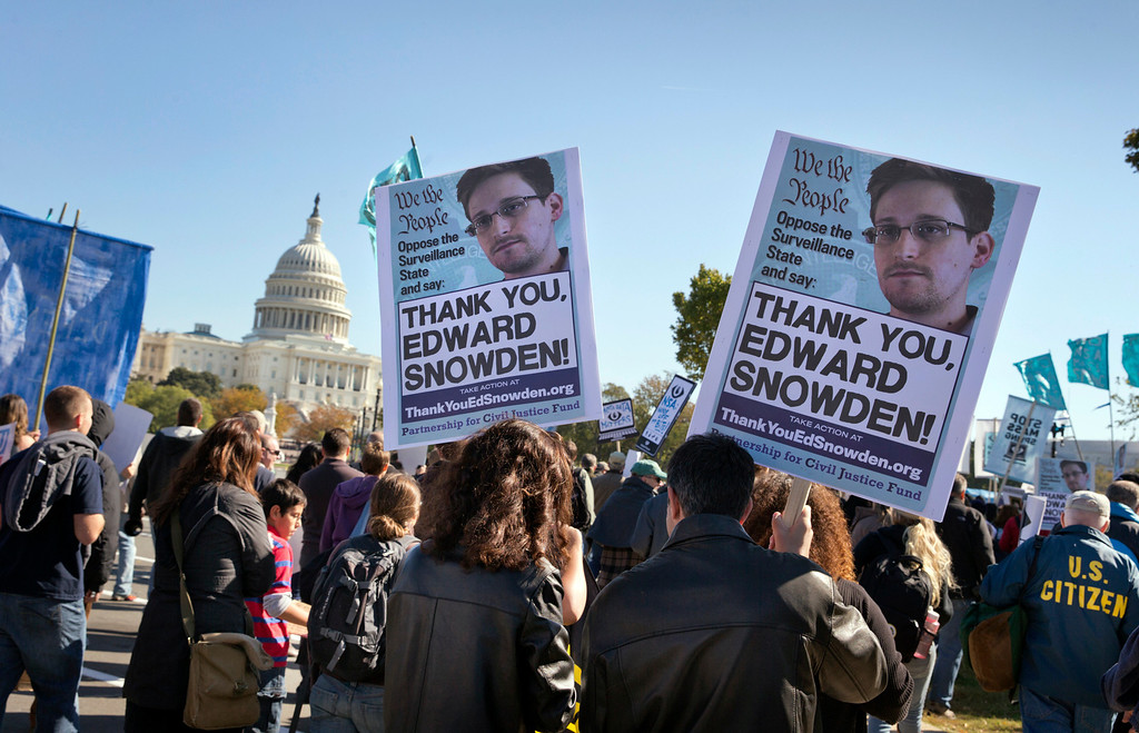 . Demonstrators rally at the U.S. Capitol to protest spying on Americans by the National Security Agency, as revealed in leaked information by former NSA contractor Edward Snowden, in Washington, Saturday, October 26, 2013.  (AP Photo/J. Scott Applewhite)
