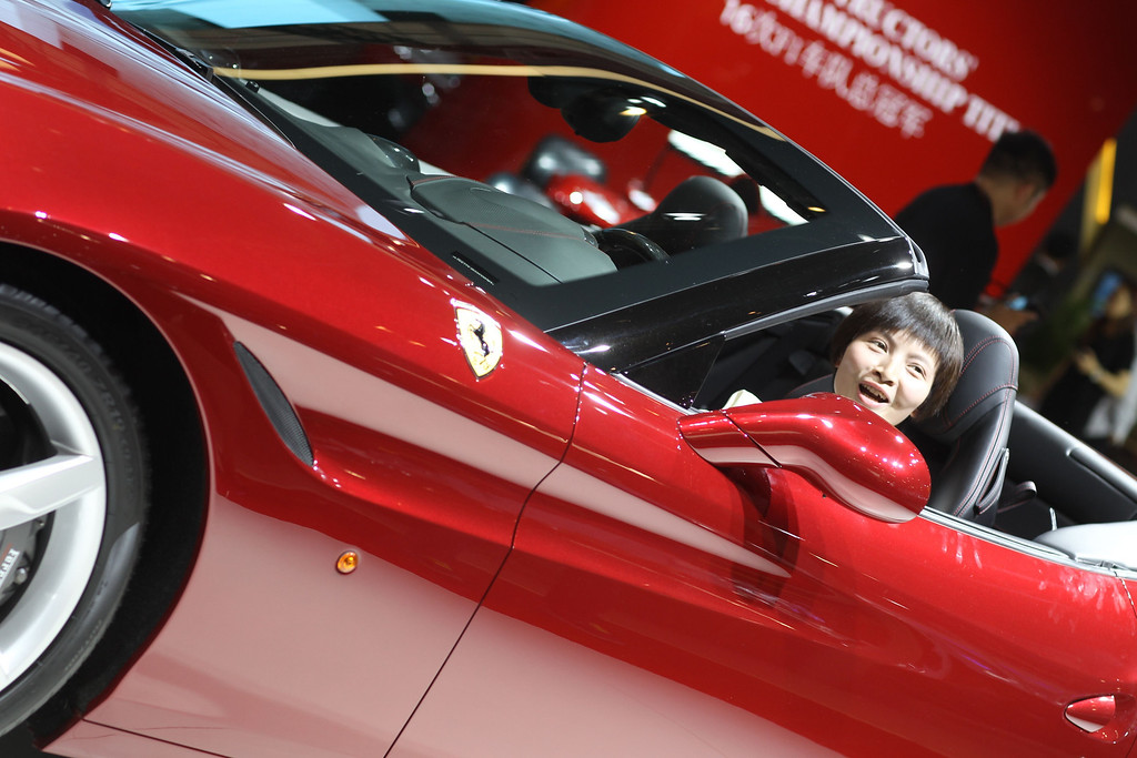 ". A visitor experiences a car on display at the China International Exhibition Center new venue during the ""Auto China 2014\"" Beijing International Automotive Exhibition in Beijing on April 21, 2014.    AFP PHOTOSTR/AFP/Getty Images"