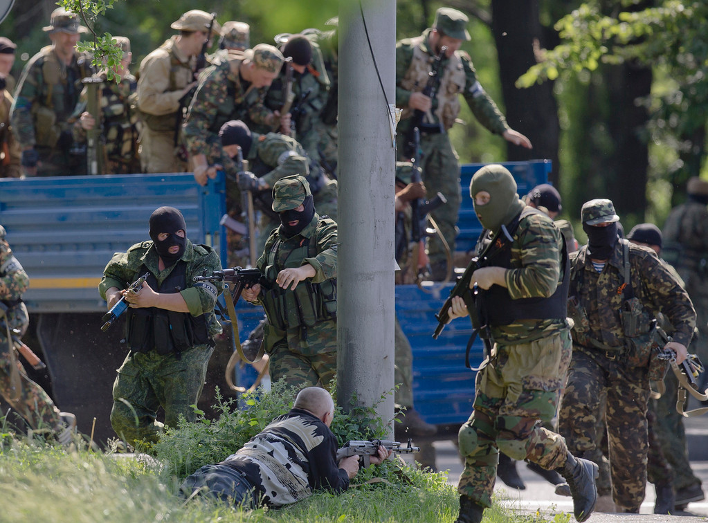 . Pro-Russian gunmen take positions near the airport, outside Donetsk, Ukraine, on Monday, May 26, 2014. Ukraine\'s military launched air strikes Monday against separatists who had taken over the airport in the eastern capital of Donetsk in what appeared to be the most visible operation of the Ukrainian troops since they started a crackdown on insurgents last month. (AP Photo/Vadim Ghirda)