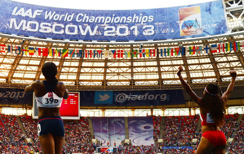 . US Brianna Rollins (R)and Great Britain\'s Tiffany Porter celebrate after winning the women\'s 100 metres hurdles final at the 2013 IAAF World Championships at the Luzhniki stadium in Moscow on August 17, 2013.    OLIVIER MORIN/AFP/Getty Images