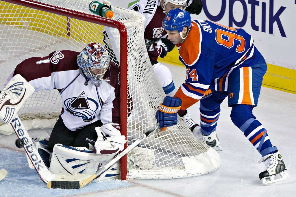 . Colorado Avalanche goalie Semyon Varlamov makes the save on Edmonton Oilers\' Ryan Smyth during the second period of an NHL hockey game in Edmonton, Alberta, Saturday, Feb. 16, 2013. (AP Photo/The Canadian Press, Jason Franson)