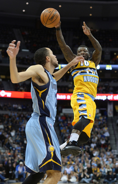 . DENVER, CO. - JANUARY 03:  Denver guard Nate Robinson (10) dumped the ball off to Ty Lawson (not pictured) who made a key shot in the last minute of the game. The Denver Nuggets broke an eight-game losing streak with a 111-108 win over the Memphis Grizzlies at the Pepsi Center Friday night, January 3, 2014. Photo By Karl Gehring/The Denver Post