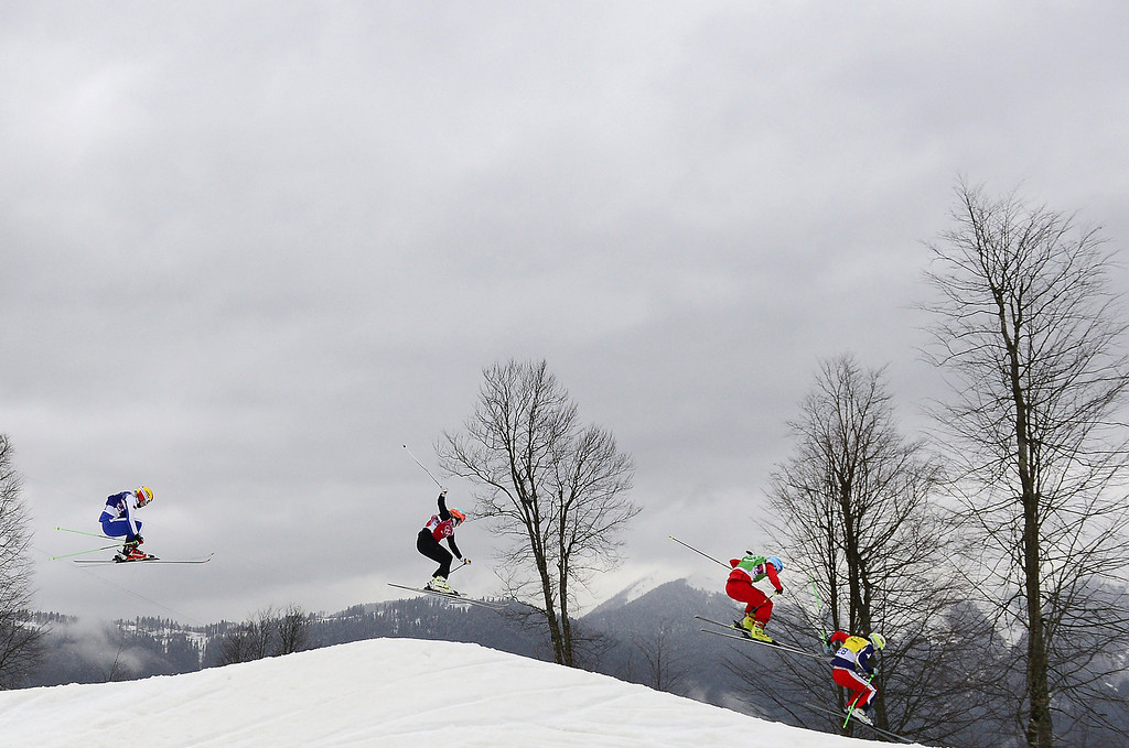 . Athletes compete in heat 3 of the Women\'s Freestyle Skiing Ski Cross 1/8 Finals at the Rosa Khutor Extreme Park during the Sochi Winter Olympics on February 21, 2014. AFP PHOTO / JAVIER SORIANO/AFP/Getty Images