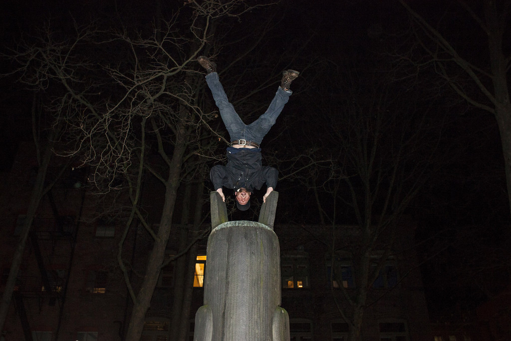 . A Seattle Seahawks fans celebrates by doing a handstand atop a sculpture after watching his team win the Super Bowl on February 2, 2014 in Seattle, Washington. The Seahawks defeated the Denver Broncos 43-8 in Super Bowl XLVIII.  (Photo by David Ryder/Getty Images)