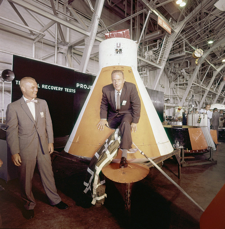 . Astronaut Scott M. Carpenter in civilian clothes, looking out of rocket nose cone with astronaut John Glenn on June 8, 1959. (AP Photo/CPG)