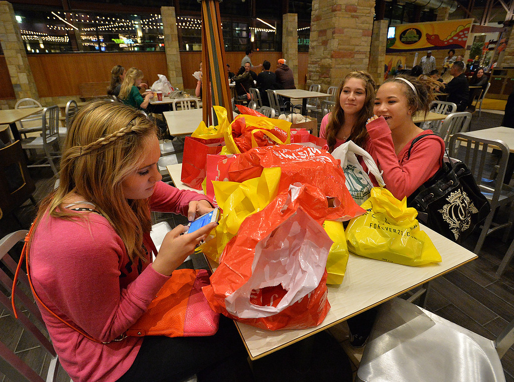 . Ashley Stover, 15, left, Katelyn Pederson, 15, and Zoe Salch, 15, take a break fro shopping in the food court at FlatIron Crossing mall on Thanksgiving Day, November 28, 2013. David R. Jennings/Boulder Daily Camera