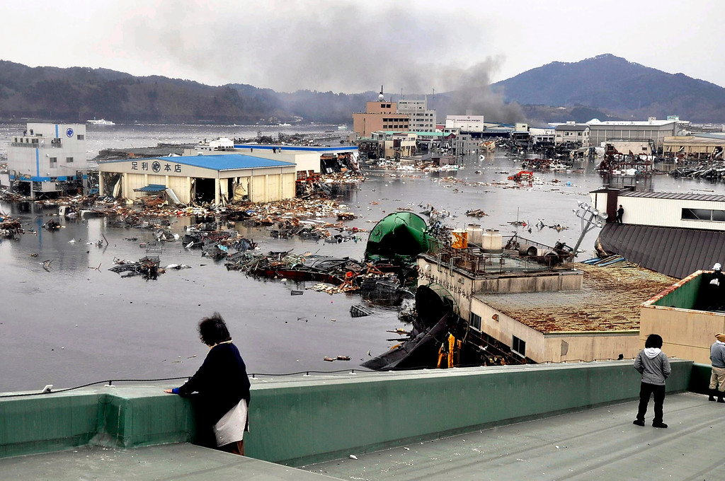 . An earthquake-triggered tsunami washes away a warehouse and vehicles in Kesennuma, Miyagi prefecture (state), Japan,  Friday March 11, 2011. The ferocious tsunami spawned by one of the largest earthquakes ever recorded slammed Japan\'s eastern coasts. (AP Photo/The Yomiuri Shimbun, Keiichi Nakane)