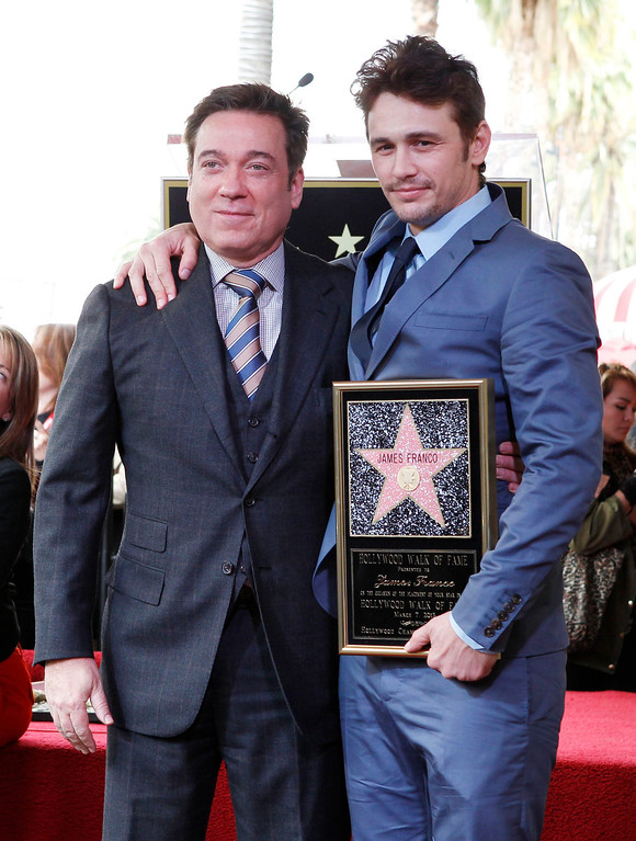 . Actor James Franco (R) poses during ceremonies unveiling his star on the Hollywood Walk of Fame with talent agent Kevin Huvane in Hollywood March 7, 2013. REUTERS/Fred Prouser