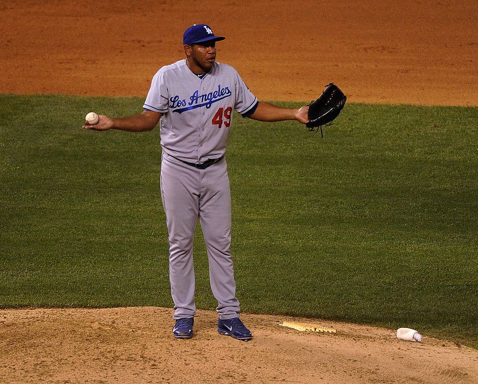 . DENVER, CO. - SEPTEMBER 4: Dodger pitcher Carlos Marmol reacted after being called for a balk. The Colorado Rockies defeated the Los Angeles Dodgers 7-5 at Coors Field Wednesday night, September 4, 2013.  Photo By Karl Gehring/The Denver Post