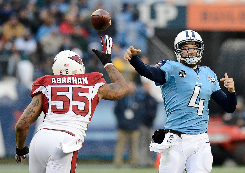 Description of . Tennessee Titans quarterback Ryan Fitzpatrick (4) passes under pressure from Arizona Cardinals outside linebacker John Abraham (55) in the first quarter of an NFL football game Sunday, Dec. 15, 2013, in Nashville, Tenn. (AP Photo/Mark Zaleski)